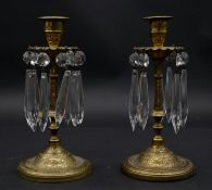 A pair of etched brass candlesticks with crystal drops. H.20cm