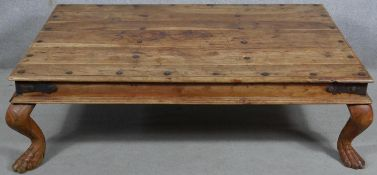 An Indian teak, metal bound and studded low table on cabriole supports. H.40 W.135 D.90cm