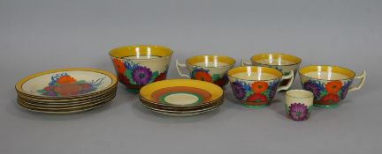 Clarice Cliff Bizarre Gayday pattern, hand decorated, four cups and their matching saucers in