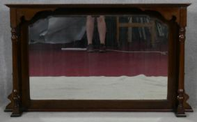 A late 19th century mahogany over mantel mirror with bevelled plate flanked by pilasters, formerly a