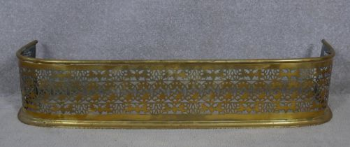 A 19th century brass fender with pierced foliate decoration. H.19 W.92 D.26cm