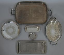 A silver plated twin handled tray along with a collection of five other silver plated trays and