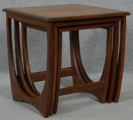 A nest of three 1970's vintage teak graduating occasional tables on shaped stretchered supports. H.