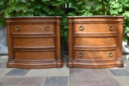 A pair of American Colonial style elm bowfronted bedside chests with marble tops. H.85 W.94 D.49cm