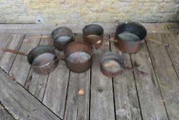 A collection of six vintage copper pans. H.23 Dia.36cm
