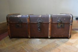 A vintage metal and teak bound travelling trunk. H.35 W.84 D.50cm