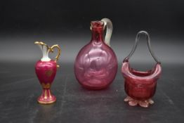 A cranberry glass jug, a posy bowl and a Limoges ewer. H.19cm (3) (jug chipped as photographed).
