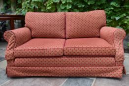 A two seater sofa in geometric upholstery. H.78 W.170 D.49cm