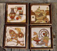 A set of four framed ceramic tiles. H.29 W.29cm