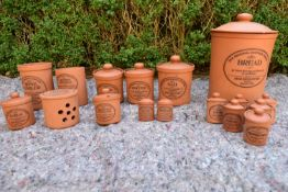 An extensive set of lidded terracotta kitchen jars, The Original Suffolk Canister by Henry