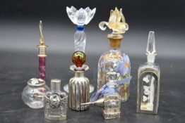 A collection of eight glass perfume bottles, hand painted and silver mounted, various hallmarks, H.