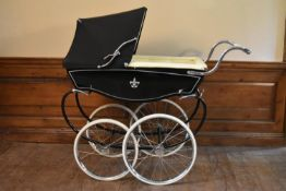 A 1974 coach built Silver Cross Dijon pram fully restored and refurbished in modern materials.