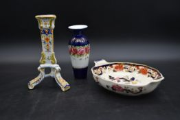 A French faience candlestick, a Mason's Imari style bowl and a 19th century floral decorated vase.