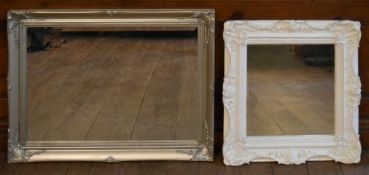 A white painted Rococo style wall mirror and a similar gilt example. H.90 W.64cm (largest)