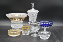 A collection of cut glass and crystal. Including a Bohemian blue cut to clear pedestal bowl, a