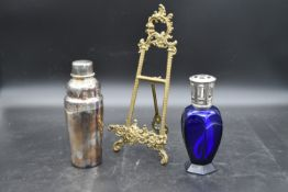 A silver plated cocktail shaker by Christofle, maker's mark to underside, a blue crystal Lampe