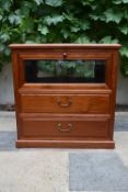 A Chinese hardwood cabinet with fall front vitrine section above two drawers on plinth base. H.66