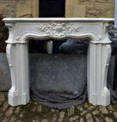 A faux marble Louis XV style moulded fibre glass fire surround. H.114 W.139 D.24.5cm