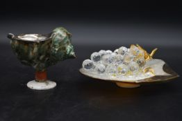 A collection of crystal and sea shells with a collection of Swarovski crystal pieces, including a