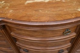 An American Colonial style bowfronted twelve drawer sideboard. H.97 W.191 D.56cm (some handles