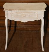 A French Provincial style distressed painted console table fitted with frieze drawer on slender