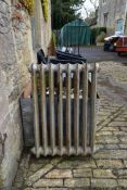 An ornate Victorian cast iron radiator. H.89 W.65cm (one foot missing).