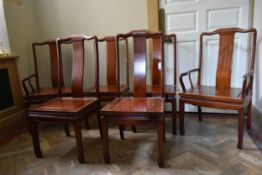 A set of six Chinese hardwood dining chairs with panel seats on shaped supports, to include two