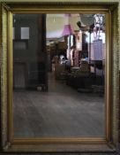 A 19th century style gilt framed wall mirror with bevelled plate. H.143.5 W. 113cm