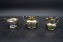 A silver milk jug, Birmingham 1925 and a matching silver plated sugar bowl and milk jug. H.9 W.