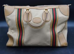 A Gucci gentleman's canvas and leather mounted holdall. H.35 W.45cm