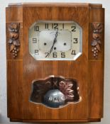 A French Art Deco burr walnut cased wall clock with silvered dial and Arabic numerals marked: