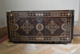 An Eastern carved hardwood hinged lidded coffer with all over bone inlaid decoration. H.45 W.86 D.