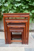 A nest of four Chinese hardwood graduating occasional tables with carved friezes on square