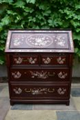 A Chinese hardwood bureau with fall front revealing fitted interior and with profuse all over mother