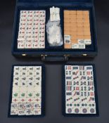 A Mah-jong set in fitted carrying case with lift out trays labelled Gino Ferrari. H.9 W.32cm