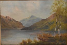 A late 19th century gilt framed oil on canvas, lake scene. H.63cm W.83cm (damaged as photographed).