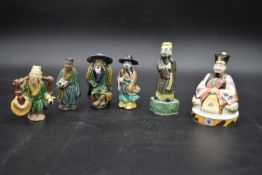 A collection of Chinese ceramic figures. Including a porcelain Royal Worcester emperor figure, and