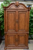 An American Colonial style elm four door cabinet enclosing fitted drawers. H.210 W.120 D.46cm
