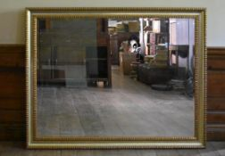 A 19th century style gilt framed wall mirror with bevelled plate. H.107 W.136.5cm