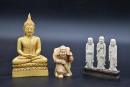 A moulded resin seated Buddha figure and two other similar items. H.15 W.8cm (Buddha)