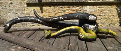 A large painted fibre glass figure of a boa constrictor along with a similar figure of another