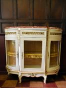 A Louis XV style ormolu mounted and painted credenza with rouge marble top above glazed doors