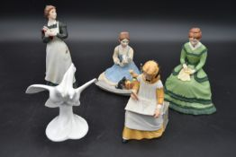 Four franklin porcelain figures from the Little Women series and a Royal Doulton figure group,