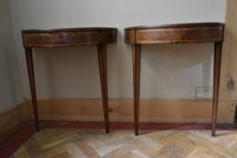 A pair of 19th century mahogany and satinwood strung demi lune console tables with inset leather