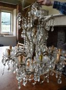 A large ten branch gilt metal and glass chandelier with cut crystal drops. H.100cm Dia.74cm (some