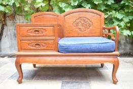 A carved Chinese hardwood hall seat fitted with drawers on cabriole supports. H.79 W.100 D.48cm