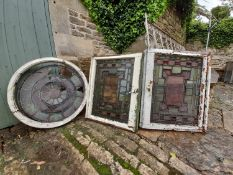 A pair of stain coloured etched and leaded glazed window frames and a similar window in circular