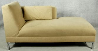 A contemporary chaise longue in faux suede upholstery on chrome supports. H.80 W.155 D.70cm