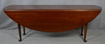 A Georgian style mahogany wake table on slender cabriole pad foot supports. H.76 L.213.5 W.153cm