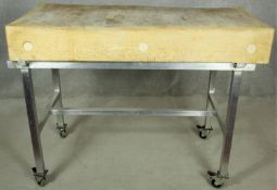 A butchers block on metal trolley base with wheel casters each fitted with a foot brake. H.95 W.